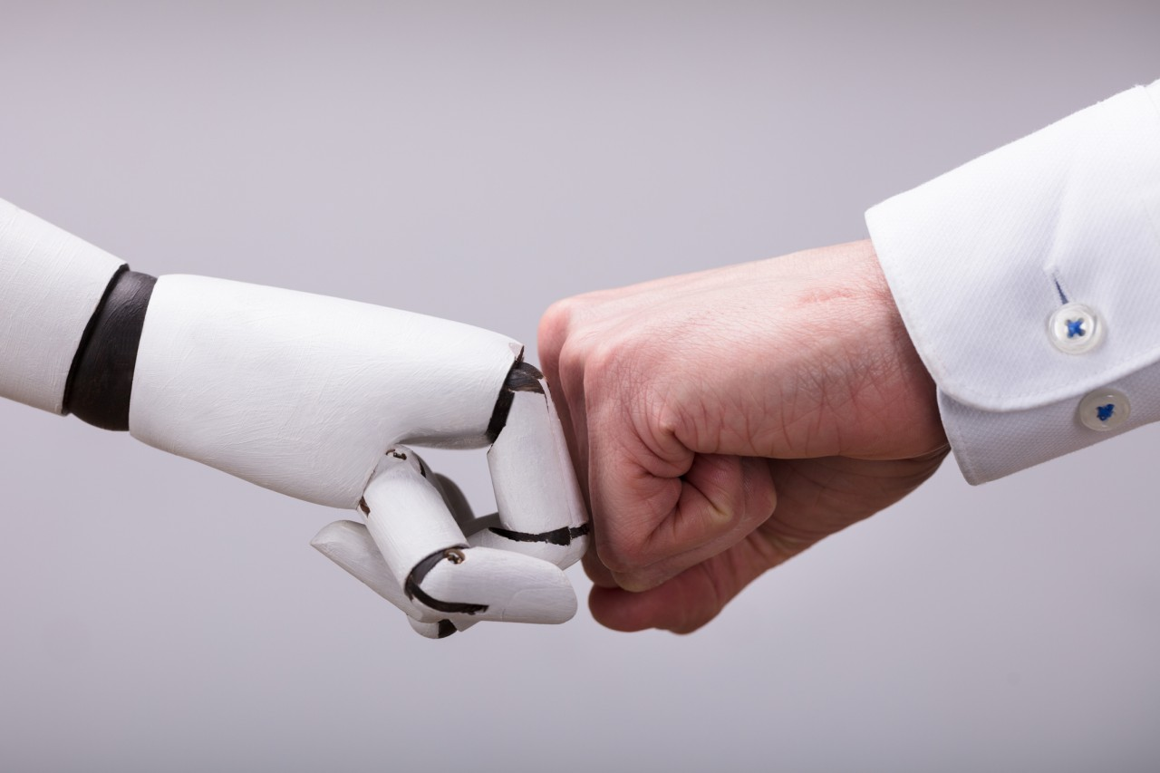 iStock-man-machine-fist-bump